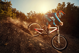 Downhill mountain bike. Man cyclist riding bicycle